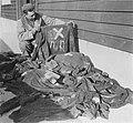 United States soldier looks at prisoner clothing at Natzweiler.jpg