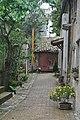 Vicolo fiorito a Villa Ficana.jpg