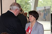 Vilija Aleknaitė-Abramikienė(Lithuania) speaks with Sec Gen Spencer Oliver.jpg