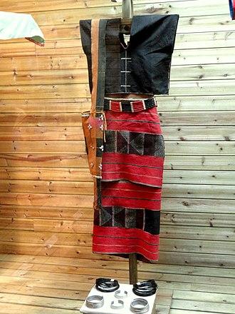 Wa States - Traditional Wa female dress and bangles. Yunnan Nationalities Museum.