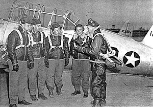 Marine Corps Air Facility Walnut Ridge - Flying cadets at Walnut Ridge AAF in front of a Vultee BT-13A Valiant, 1943 (Serial 41-23074 visible)