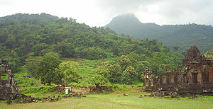 Wat Phou: from left, the south palace, the tiers leading to the central sanctuary, the mountain peak shrouded in mist, and the north palace.