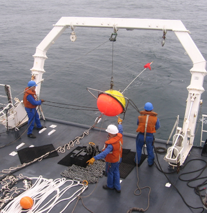 Metocean - Deployment of a Datawell waverider buoy near the southwestern coast of France, for the measurement of ocean wave statistics, like the significant wave height and period, wave direction and power spectrum.