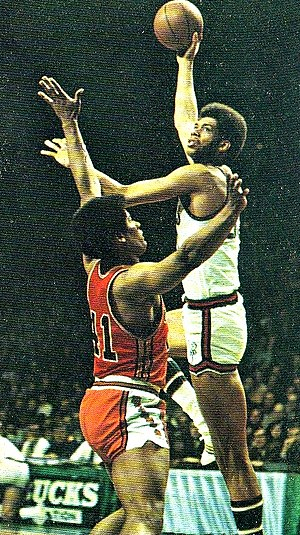 Kareem Abdul-Jabbar - Alcindor displaying his trademark sky-hook over Wes Unseld of the Baltimore Bullets