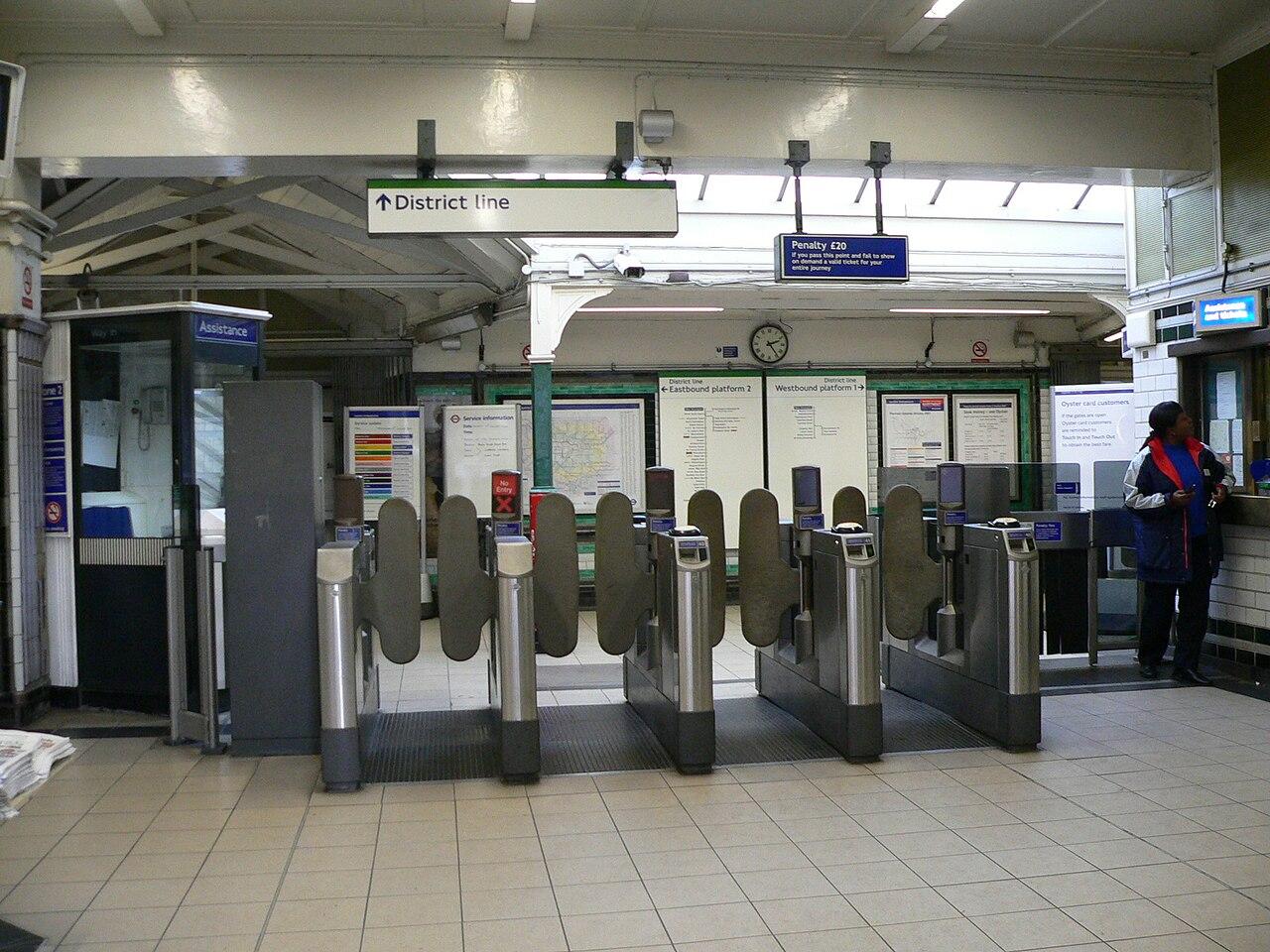 1280px-West_Kensington_tube_station_gate