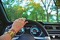 Woman hand steering wheel (Unsplash).jpg