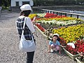 Woman taking picture of her daughter in a park in Misaki, Japan; August 2009.jpg