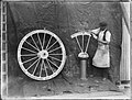Workman posed with Noakes patent composite wheel, (2821106432).jpg