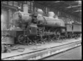 """A"" class steam locomotive no 604, 4-6-2 type, under construction in a railway workshop. ATLIB 178919.png"
