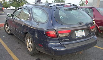 Trim level (automobile) - SE badge on a Ford Taurus, indicating the lowest trim level