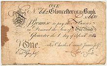 Old piece of paper money with the inscription in script-appearing text