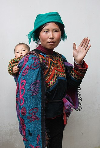 Yi people - Yi woman in traditional dress with a child