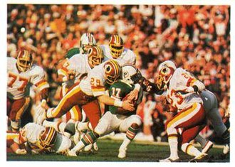 Super Bowl XVII - Redskins safety Mark Murphy tackling Dolphins running back Andra Franklin.