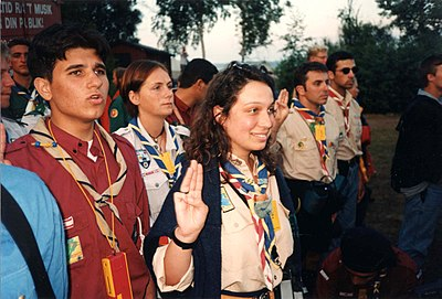 Scouts using the three-finger salute as the Scout Sign. 1996-Rover Moot-Fahnengruss.jpg