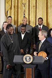 Wallace is honored with the Pistons at the White House for the team's victory in the 2004 NBA Finals.