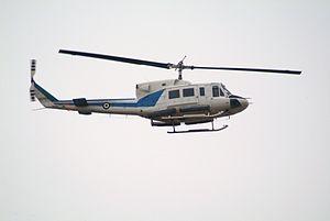 30765 Bell 212 358 MED Hellenic Air Force flying over Athens.jpg