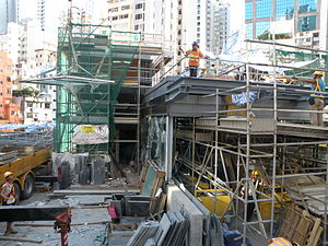 A1 entrance and exit of Sai Ying Pun Station under construction in August 2014.JPG