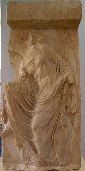 Temple of Athena Nike - A relief from the parapet around the temple which shows an ancient goddess fixing her sandal. It is housed at the Acropolis Museum