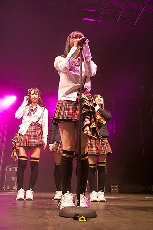 Kogal - Japanese idol girl group AKB48 performs in kogal uniforms.