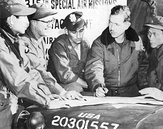 """Air Resupply And Communications Service - USAF and Army officers coordinating a """"Special Air Mission"""" with their South Korean counterparts during the Korean War, 1951. Major Harry C. Aderholt is second from right, in the fur-collared flight jacket."""