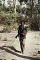 ASC Leiden - Coutinho Collection - C 40 - Walk from Candjambary to Sara, Guinea-Bissau - Military escort with rifle during trip - 1974.tif