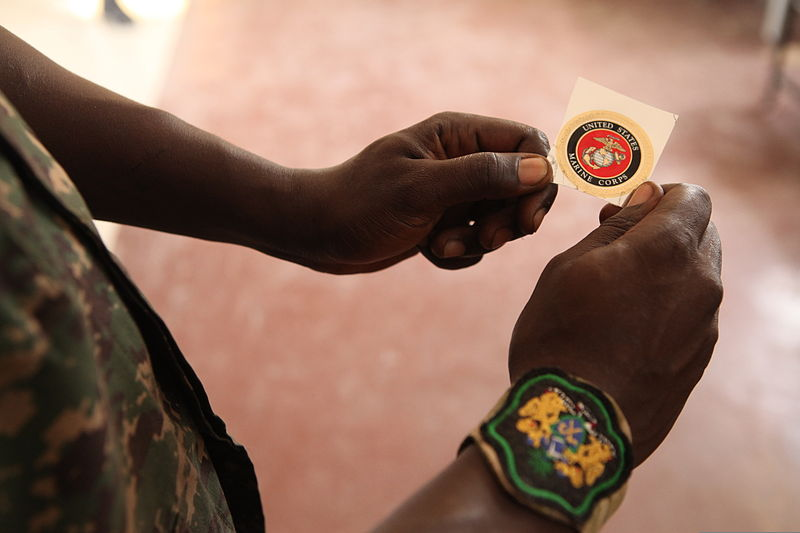 File:A Gambian soldier looks at a U.S. Marine Corps sticker he received  after finishing an intelligence capacity building workshop taught by U.S.  Marines ...