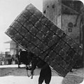 A Jerusalem porter carrying fifty empty petrol tins on his back LCCN2002699563 (cropped).jpg