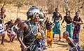 A Man from Gogo Tribe singing while palying Zeze with his tribe mate, Zeze is one of the famous Musical Instrumental In Tanzania.jpg