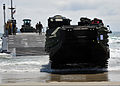 A U.S. Marine Corps assault amphibious vehicle is driven off an Improved Navy Lighterage System during a maritime prepositioning force training scenario June 12, 2013, in Coronado, Calif., as part of exercise 130612-N-OP638-141.jpg