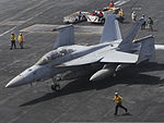 A U.S. Navy F-A-18F Super Hornet aircraft assigned to Strike Fighter Squadron (VFA) 154 prepares to launch from the aircraft carrier USS Nimitz (CVN 68) June 18, 2013, in the Gulf of Oman 130618-N-AZ866-146.jpg