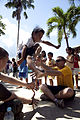 A boy at Alfonso XIII Elementary School plays a high jump game as U.S. Navy Hospital Corpsman 3rd Class Camden Boyd, sitting right, and Marine Corps Hospitalman Christopher Baldwin, sitting left, both assigned 111026-M-VG363-533.jpg