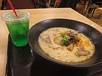 A perfectly fine bowl of spicy and sweet and sour tonkotsu ramen at an unknown place in the Narita airport along with a melon pop that was as sweet as it was green (25617762317).jpg