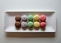 A rainbow of macarons on a white tray.jpg