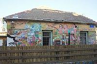 Abandoned house in Tel Aviv covered in graffiti.jpg