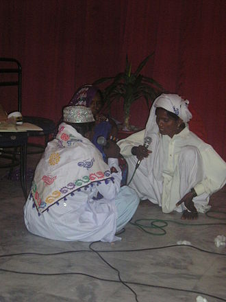 Music of Pakistan - A trio of Pakistani folk singers performing at a local gathering