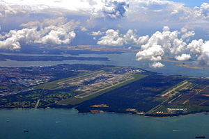 Singapore Changi Airport - Aerial view of Singapore Changi Airport. The forested area to the right of the airfield has since been cleared for Terminal 5.