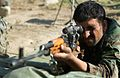 Afghan National Army soldier practices aiming his PSL rifle.jpg