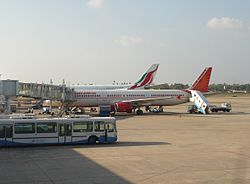 Air India and SriLankan aircraft at colomobo airport terminal.jpg