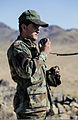 An Afghan National Army commando with the 1st Tolai, 3rd Special Operations Kandak conducts a radio check with fellow commandos during a clearing operation in the Shah Wali Kot district of Kandahar province 131111-A-XP635-134.jpg
