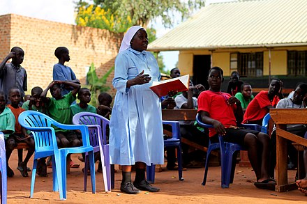 A Ugandan nun teaching during a community service day An Ugandan nun teaching during a community service day.jpg