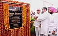 Anand Sharma and the Chief Minister of Haryana, Shri Bhupinder Singh Hooda unveiling the plaque to lay the foundation stone of National Institute of Design (NID), at Umari, Kurukshetra, Haryana on May 22, 2013.jpg