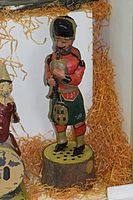 Antique wind-up toy bagpipes player (24516473733).jpg