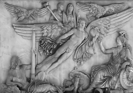 A winged genius raises Antoninus Pius and his Empress Faustina in apotheosis, escorted by two eagles. From the column-base of Antoninus Pius, Vatican. Antonius Pius Column Base.JPG
