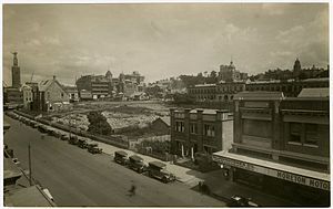 ANZAC Square, Brisbane - Anzac Square construction site, looking along Adelaide Street towards City Hall, 1929