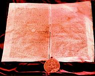 An old manuscript with a large seal depicting a king