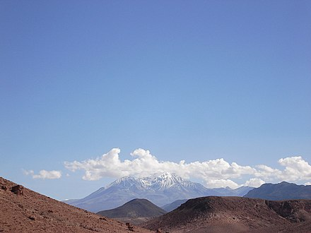 The landscape in the region; Taapaca is the two snow-covered mountains Arica023.jpg