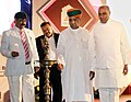 """Arjun Ram Meghwal lighting the lamp to inaugurate the """"Digital India Summit – Role of Cooperative Banks in adopting and advancing the Prime Minister's Flagship Digital India Program"""", in Mumbai.jpg"""