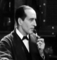 Arthur Wontner as Sherlock Holmes in The Sleeping Cardinal.png