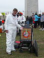 Artist in white jumpsuit at Washington Monument Inauguration 2013.jpg