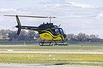 Ausjet-Heli Experiences (VH-JGE) Bell 206B Jet Ranger III taking off from Wagga Wagga Airport.jpg